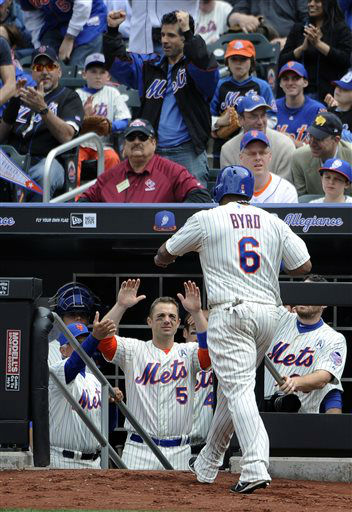 "<div class=""meta ""><span class=""caption-text "">New York Mets manager Terry Collins and David Wright (5) greet Marlon Byrd (6) at the dugout after his first at-bat as a Met for an RBI single off of San Diego Padres starting pitcher Edinson Volquez in the third inning of an opening day baseball game at Citi Field on Monday, April 1, 2013 in New York. The Mets defeated the Padres 11-2. (AP Photo/Kathy Kmonicek) (AP Photo/ Kathy Kmonicek)</span></div>"