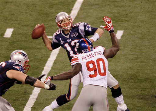 "<div class=""meta ""><span class=""caption-text "">New England Patriots quarterback Tom Brady (12) throws the last pass of the game as New York Giants defensive end Jason Pierre-Paul (90) defends during the second half of the NFL Super Bowl XLVI football game, Sunday, Feb. 5, 2012, in Indianapolis. (AP Photo/Charlie Riedel) (Photo/Charlie Riedel)</span></div>"