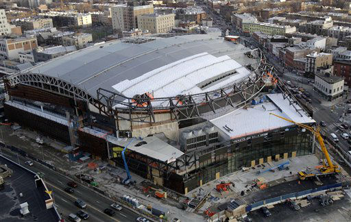 "<div class=""meta ""><span class=""caption-text "">The still under-construction Barclays Center, which will be home to the Brooklyn Nets NBA basketball team, stands in New York on Wednesday, Feb. 1, 2012. The Brooklyn sports and entertainment arena is slated to open in September, 2012. It will be the first time since the Brooklyn Dodgers left in 1957 that the borough will have a major league sports team to call its own. The New Jersey Devils and the New York Islanders are scheduled to play a preseason hockey game there in October. (AP Photo/Kathy Willens) (AP Photo/ Kathy Willens)</span></div>"