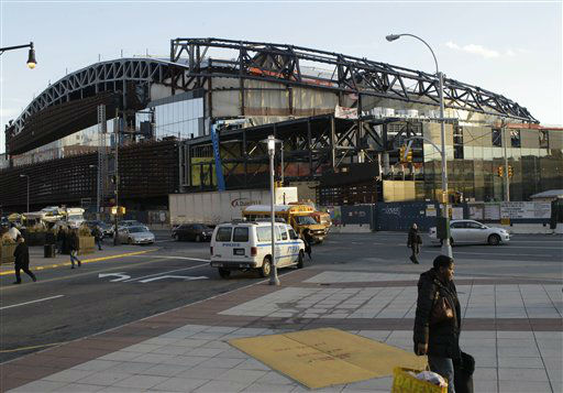 Pedestrians and drivers travel near the under-construction Barclays Center, which will be home to the Brooklyn Nets NBA basketball team, in New York on Wednesday, Feb. 1, 2012. The Brooklyn sports and entertainment arena is slated to open in September, 2012.  It will be the first time since the Brooklyn Dodgers left in 1957 that the borough will have a major league sports team to call its own. The New Jersey Devils and the New York Islanders are scheduled to play a preseason hockey game there in October. &#40;AP Photo&#47;Kathy Willens&#41; <span class=meta>(AP Photo&#47; Kathy Willens)</span>