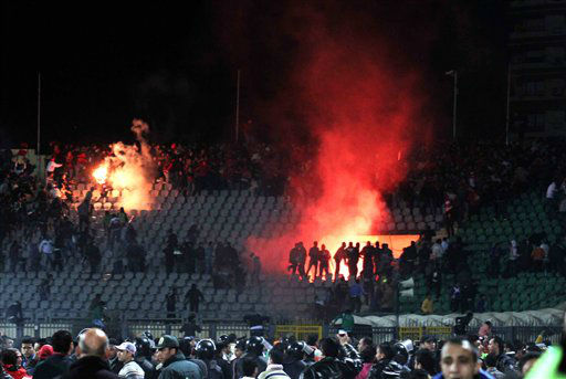 "<div class=""meta ""><span class=""caption-text "">Egyptian fans rush into the field following Al-Ahly club soccer match against Al-Masry club at the soccer stadium in Port Said, Egypt Wednesday, Feb. 1, 2012. Dozens of Egyptians were killed Wednesday in violence following a soccer match in Port Said, when fans flooded the field seconds after a match against a rival team was over, Egypt's Health ministry said. (AP Photo) (AP Photo/ STR)</span></div>"