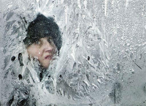 "<div class=""meta ""><span class=""caption-text "">A woman looks out of a window covered in frost on a bus in Bucharest, Romania, Thursday, Feb. 2, 2012. At least 11,000 villagers have been trapped by heavy snow and blizzards in Serbia's mountains, authorities said Thursday, as the death toll from Eastern Europe's weeklong deep freeze rose to 122, many of them homeless people. (AP Photo/Vadim Ghirda) (AP Photo/ Vadim Ghirda)</span></div>"