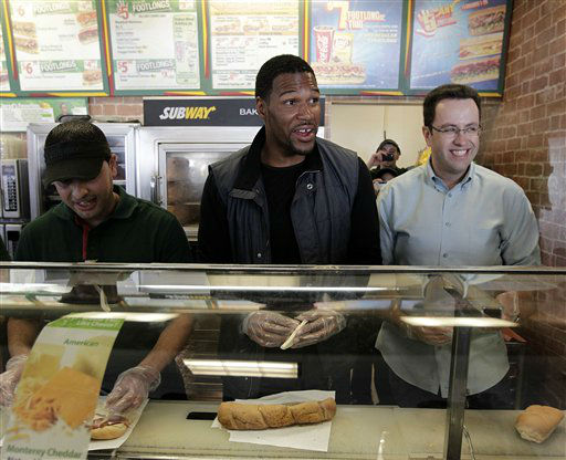 COMMERCIAL IMAGE - In this photo taken by AP Images for Subway, former NY defensive end and world champion Michael Strahan, center, and Jared Fogle, right, serve up free &#36;5 footlongs with in celebration of Subway&#39;s FebruANY and the big game in Indianapolis, Thursday, Feb. 2, 2012. &#40;AJ Mast &#47;AP Images for Subway&#41; <span class=meta>(Photo&#47;AJ Mast)</span>