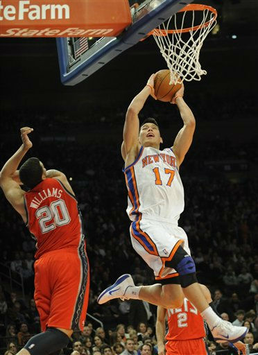 "<div class=""meta image-caption""><div class=""origin-logo origin-image ""><span></span></div><span class=""caption-text"">New York Knicks guard Jeremy Lin, right, goes up with a shot past New Jersey Nets guard Deron Williams during the second quarter of an NBA basketball game on Saturday, Feb. 4, 2012, at Madison Square Garden in New York. (AP Photo/Bill Kostroun) (AP Photo/ Bill Kostroun)</span></div>"