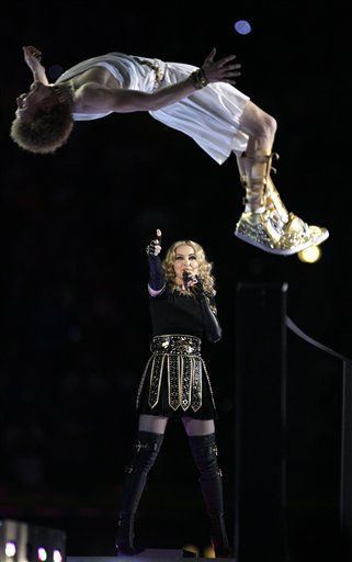 "<div class=""meta image-caption""><div class=""origin-logo origin-image ""><span></span></div><span class=""caption-text"">Madonna performs during halftime of the NFL Super Bowl XLVI football game between the New York Giants and the New England Patriots Sunday, Feb. 5, 2012, in Indianapolis. (AP Photo/Marcio Jose Sanchez) (AP Photo/ Marcio Jose Sanchez)</span></div>"