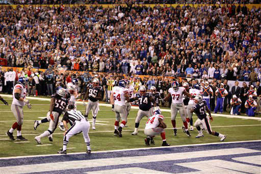 New York Giants Ahmad Bradshaw #44 scores the game-winning touchdown against the New England Patriots at Super Bowl XLVI on Sunday, February 5, 2012 in Indianapolis, IN. The Giants defeated the Patriots 21-17. (AP Photo/Gregory Payan