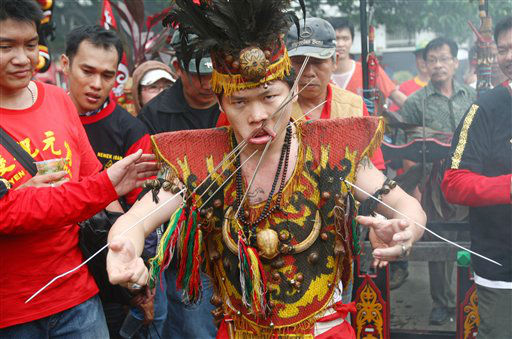 A worshipper pierces his cheeks with metal skewers during Cap Go Meh festival that marks the end of Lunar New Year celebrations in Jakarta, Indonesia, Monday, Feb. 6, 2012. &#40;AP Photo&#47;Tatan Syuflana&#41; <span class=meta>(AP Photo&#47; Tatan Syuflana)</span>