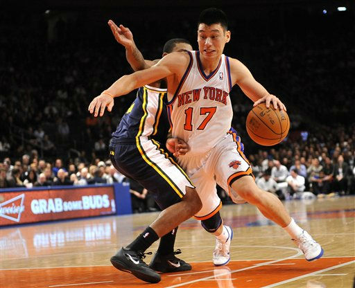 New York Knicks&#39; point guard Jeremy Lin &#40;17&#41; drives the ball against Utah Jazz&#39;s point guard Earl Watson &#40;11&#41; during an NBA basketball game on Monday, Feb. 6, 2012, in New York. &#40;AP Photo&#47;Kathy Kmonicek&#41; <span class=meta>(AP Photo&#47; Kathy Kmonicek)</span>