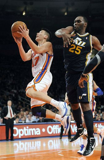 New York Knicks&#39; Jeremy Lin &#40;17&#41; drives the ball to the basket next to Utah Jazz&#39;s Al Jefferson &#40;25&#41; during the second half of an NBA basketball game Monday, Feb. 6, 2012, in New York. Lin scored 28 points as the Knicks won 99-88. &#40;AP Photo&#47;Kathy Kmonicek&#41; <span class=meta>(AP Photo&#47; Kathy Kmonicek)</span>
