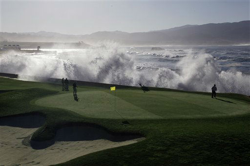 Greenskeepers look on as waves crash over the seawall on the 18th hole of the Pebble Beach Golf Links during a practice round at the AT&#38;T Pebble Beach National Pro-Am PGA Tour golf tournament in Pebble Beach, Calif., Wednesday, Feb. 8, 2012. &#40;AP Photo&#47;Eric Risberg&#41; <span class=meta>(AP Photo&#47; Eric Risberg)</span>