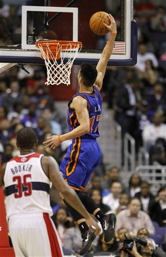 New York Knicks point guard Jeremy Lin &#40;17&#41; goes up for a dunk in front of Washington Wizards forward Trevor Booker &#40;35&#41; during the second half of an NBA basketball game, Wednesday, Feb. 8, 2012, in Washington. The Knicks won 107-93. &#40;AP Photo&#47;Haraz N. Ghanbari&#41; <span class=meta>(AP Photo&#47; Haraz N. Ghanbari)</span>