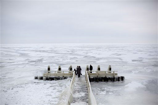 "<div class=""meta ""><span class=""caption-text "">Tourists admire the frozen IJsselmeer inland sea on Afsluitdijk, a dike closing off the Wadden sea and North Sea from IJsselmeer inland sea, northern Netherlands, Thursday Feb. 9, 2012. Organizers of the near-mythical Eleven Cities Tour dealt 16,000 skaters and the nation at large a crushing blow Wednesday when they decided the ice was too thin to hold the 125-mile (200-kilometer) skating marathon for the first time in 15 years. (AP Photo/Peter Dejong) (AP Photo/ Peter Dejong)</span></div>"
