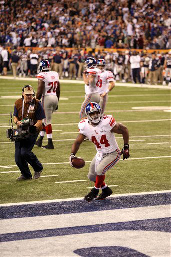 New York Giants Ahmad Bradshaw #44 celebrates the game-winning touchdown against the New England Patriots at Super Bowl XLVI on Sunday, February 5, 2012 in Indianapolis, IN. The Giants defeated the Patriots 21-17. (AP Photo/Gregory Payan)