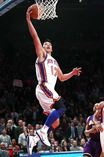 New York Knicks&#39; Jeremy Lin &#40;17&#41; drives past Los Angeles Lakers&#39; Derek Fisher during the first half of an NBA basketball game, Friday, Feb. 10, 2012, in New York. &#40;AP Photo&#47;Frank Franklin II&#41; <span class=meta>(AP Photo&#47; Frank Franklin II)</span>