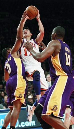 New York Knicks&#39; Jeremy Lin &#40;17&#41; drives past Los Angeles Lakers&#39; Andrew Goudelock &#40;0&#41; and Andrew Bynum &#40;17&#41; during the first half of an NBA basketball game, Friday, Feb. 10, 2012, in New York. &#40;AP Photo&#47;Frank Franklin II&#41; <span class=meta>(AP Photo&#47; Frank Franklin II)</span>