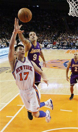 New York Knicks&#39; Jeremy Lin &#40;17&#41; drives past Los Angeles Lakers&#39; Matt Barnes &#40;9&#41; during the first half of an NBA basketball game, Friday, Feb. 10, 2012, in New York. &#40;AP Photo&#47;Frank Franklin II&#41; <span class=meta>(AP Photo&#47; Frank Franklin II)</span>