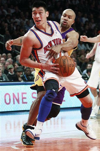 New York Knicks&#39; Jeremy Lin &#40;17&#41; spins past Los Angeles Lakers&#39; Derek Fisher &#40;2&#41; during the first half of an NBA basketball game, Friday, Feb. 10, 2012, in New York. &#40;AP Photo&#47;Frank Franklin II&#41; <span class=meta>(AP Photo&#47; Frank Franklin II)</span>