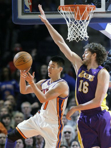 New York Knicks&#39; Jeremy Lin &#40;17&#41; passes away from Los Angeles Lakers&#39; Pau Gasol &#40;16&#41;, of Spain, during the second half of an NBA basketball game Friday, Feb. 10, 2012, in New York. The Knicks won the game 92-85. &#40;AP Photo&#47;Frank Franklin II&#41; <span class=meta>(AP Photo&#47; Frank Franklin II)</span>