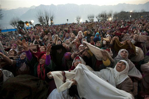 Kashmiri Muslim women pray as the head priest, unseen, displays a relic of Islam&#39;s Prophet Muhammad at the Hazratbal shrine on the Friday following Eid Milad-un Nabi, marking the birth anniversary of Prophet Mohammad, in Srinagar, India, Friday, Feb. 10, 2012. Thousands of Kashmiri Muslims gathered at the Hazratbal shrine, which houses a relic believed to be a hair from the beard of the Prophet. &#40;AP Photo&#47;Dar Yasin&#41; <span class=meta>(AP Photo&#47; Dar Yasin)</span>