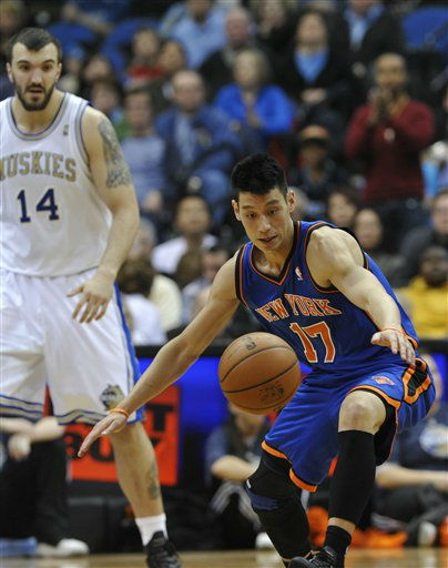 New York Knicks&#39; Jeremy Lin, right, reaches for the loose ball as Minnesota Timberwolves&#39; Nikola Pekovic, left, of Montenegro, watches in the first half of an NBA basketball game on Saturday, Feb. 11, 2012, in Minneapolis. The Timberwolves wore throwback uniforms from the 1967 Minnesota Muskies team. &#40;AP Photo&#47;Jim Mone&#41; <span class=meta>(AP Photo&#47; Jim Mone)</span>