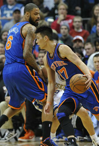 "<div class=""meta ""><span class=""caption-text "">New York Knicks' Tyson Chandler, left, sets a pick on Minnesota Timberwolves' Ricky Rubio, of Spain, as Jeremy Lin , right, drives in the first half of an NBA basketball game on Saturday, Feb. 11, 2012, in Minneapolis. (AP Photo/Jim Mone) (AP Photo/ Jim Mone)</span></div>"
