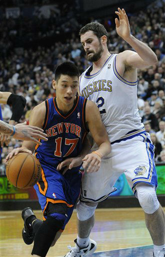 New York Knicks&#39; Jeremy Lin, left, and Minnesota Timberwolves&#39; Kevin Love  in the second half of an NBA basketball game Saturday, Feb. 11, 2012, in Minneapolis. The Knicks won 100-98.  &#40;AP Photo&#47;Jim Mone&#41; <span class=meta>(AP Photo&#47; Jim Mone)</span>