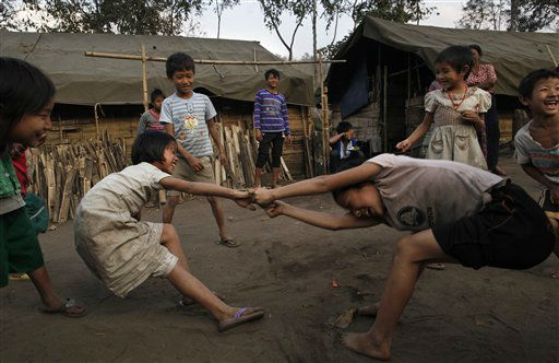 "<div class=""meta image-caption""><div class=""origin-logo origin-image ""><span></span></div><span class=""caption-text"">Children play in a refugee camps in Laiza, an area controlled by the Kachin, northern Myanmar, Sunday, Feb. 12, 2012. An estimated 40,000 Kachin people have been rendered homeless by continued fighting between the Kachin ethnic minority and Myanmar government. (AP Photo/Vincent Yu) (AP Photo/ Vincent Yu)</span></div>"