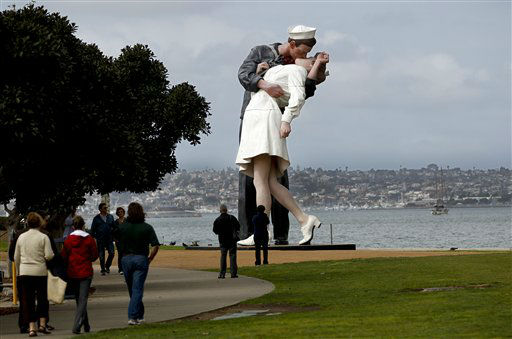 The statue entitled Unconditional Surrender stands tall in the parkway along the waterfront Monday, Feb. 13, 2012 in San Diego. The statue, which was modeled after a photograph by Alfred Eisenstaedt taken in Times Square on V-J Day at the end of World War II,  is schedule to be moved at the end of the month. &#40;AP Photo&#47;Lenny Ignelzi&#41; <span class=meta>(AP Photo&#47; Lenny Ignelzi)</span>