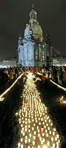 People light  candles commemorating  the 67th anniversary of the Allied bombing of Dresden during WWII in Dresden, Germany, Monday, Feb. 13, 2012. British and U.S. bombers on Feb. 13-14, 1945 destroyed Dresden&#39;s centuries-old baroque city center.  In background the 18th-century Frauenkirche , Church of Our Lady.  &#40;AP Photo&#47;Jens Meyer&#41; <span class=meta>(AP Photo&#47; Jens Meyer)</span>