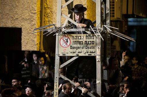 In this Tuesday, Feb. 14, 2012 photo Ultra-Orthodox Jews gather for the traditional Jewish wedding of Chananya Yom Tov Lipa, the great-grandson of the Rabbi of the Wiznitz Hasidic followers, in the ultra-Orthodox town of Bnei Brak near Tel Aviv, Israel.&#40;AP Photo&#47;Oded Balilty&#41; <span class=meta>(AP Photo&#47; Oded Balilty)</span>
