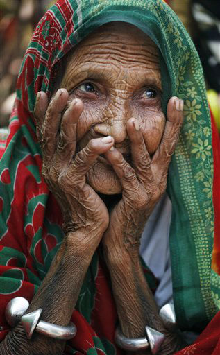 Rajji, 75, rests after casting her vote outside a polling station in Varanasi, India, Wednesday, Feb. 15, 2012. The third phase of the seven-phased elections in Uttar Pradesh, India&#39;s most populous and politically crucial state, is being held Wednesday. &#40;AP Photo&#47;Rajesh Kumar Singh&#41; <span class=meta>(AP Photo&#47; Rajesh Kumar Singh)</span>