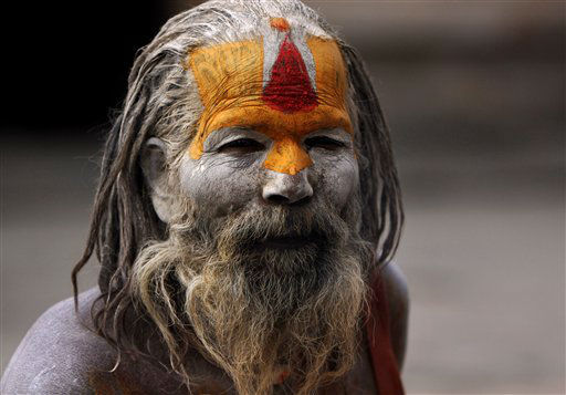 A Hindu holy man, with his face and body smeared with ash sits at the Pashupatinath Temple in Katmandu, Nepal, Wednesday, Feb. 15, 2012. Hindu holy men from Nepal and India have started arriving at the temple ahead of the Shivaratri festival dedicated to the worship of Lord Shiva which falls on Feb. 20. &#40;AP Photo&#47;Binod Joshi&#41; <span class=meta>(AP Photo&#47; Binod Joshi)</span>