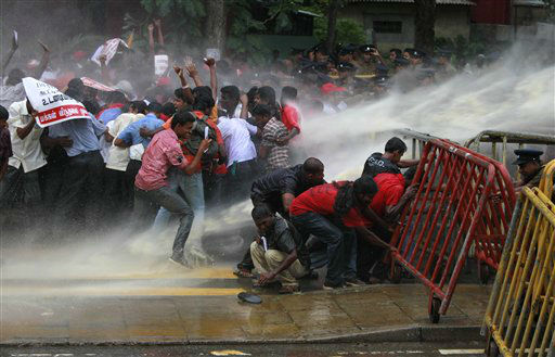 "<div class=""meta ""><span class=""caption-text "">Members of Sri Lanka's People's Liberation Front brave police water cannons during a protest in Colombo, Sri Lanka, Wednesday, Feb. 15, 2012 . A wave of protests have swept across the country after the government increased fuel prices from Saturday night. (AP Photo/Eranga Jayawardena) (AP Photo/ Eranga Jayawardena)</span></div>"