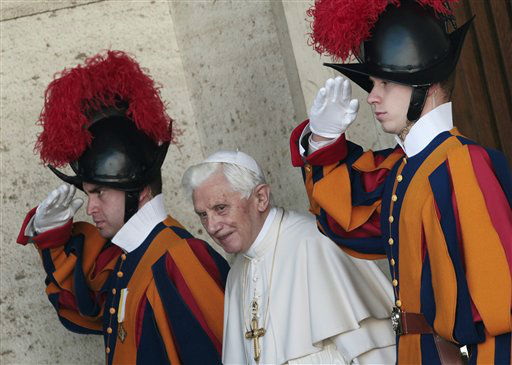 Pope Benedict XVI is saluted by Swiss guards as he leaves the Synod hall after a meeting with Cardinals and Bishops at the Vatican, Friday, Feb. 17, 2012. The Pontiff is scheduled to name 22 new Cardinals in a Consistory, Saturday Feb. 18, at the Vatican. &#40;AP Photo&#47;Gregorio Borgia&#41; <span class=meta>(AP Photo&#47; Gregorio Borgia)</span>
