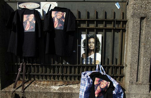 Whitney Houston merchandise is displayed for sale as fans gather a few blocks from the New Hope Baptist Church before the singer&#39;s funeral in Newark, N.J., Saturday, Feb. 18, 2012. &#40;AP Photo&#47;Jason DeCrow&#41; <span class=meta>(AP Photo&#47; Jason DeCrow)</span>