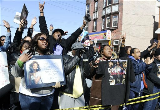 Fans sing near the funeral service for singer Whitney Houston at the New Hope Baptist Church in Newark, N.J.,  Saturday, Feb. 18, 2012. &#40;AP Photo&#47;Charles Sykes&#41; <span class=meta>(AP Photo&#47; Charles Sykes)</span>