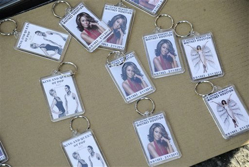 Key chains with photos of Whitney Houston are displayed for sale on the street near funeral services for the singer at the New Hope Baptist Church in Newark, N.J.,  Saturday, Feb. 18, 2012. &#40;AP Photo&#47;Charles Sykes&#41; <span class=meta>(AP Photo&#47; Charles Sykes)</span>