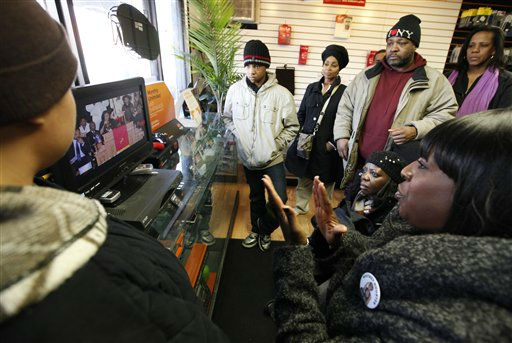 Whitney Houston fans gather around a television in a mobile phone store a few blocks from the New Hope Baptist Church to watch the singer&#39;s funeral in Newark, N.J., Saturday, Feb. 18, 2012. Houston died last Saturday at the Beverly Hills Hilton in Beverly Hills, Calif., at the age 48. &#40;AP Photo&#47;Jason DeCrow&#41; <span class=meta>(AP Photo&#47; Jason DeCrow)</span>