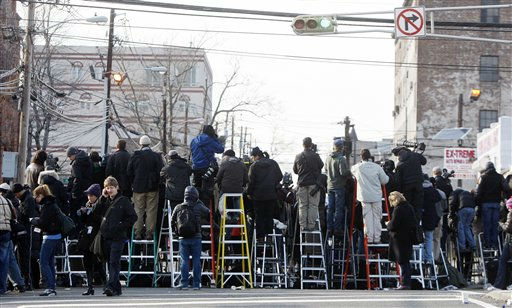 Photographers stand on ladders to get a view of Whitney Houston&#39;s funeral at New Hope Baptist Church in Newark, N.J., Saturday, Feb. 18, 2012. Houston died last Saturday at the Beverly Hills Hilton in Beverly Hills, Calif., at the age 48. &#40;AP Photo&#47;Rich Schultz&#41; <span class=meta>(AP Photo&#47; Rich Schultz)</span>