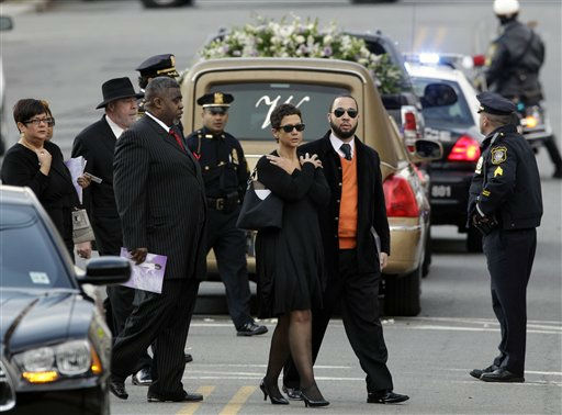 Mourners walk past the hearse with Whitney Houston&#39;s casket after her funeral at New Hope Baptist Church in Newark, N.J., Saturday, Feb. 18, 2012.  Houston died last Saturday at the Beverly Hills Hilton in Beverly Hills, Calif., at the age 48. &#40;AP Photo&#47;Mel Evans&#41; <span class=meta>(AP Photo&#47; Mel Evans)</span>