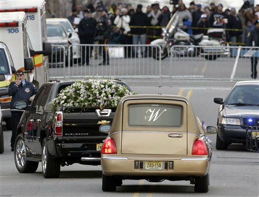 "<div class=""meta ""><span class=""caption-text "">A flower car leads the hearse with Whitney Houston's casket after her funeral at New Hope Baptist Church in Newark, N.J., Saturday, Feb. 18, 2012. Houston died last Saturday at the Beverly Hills Hilton in Beverly Hills, Calif., at the age 48. (AP Photo/Mel Evans) (AP Photo/ Mel Evans)</span></div>"