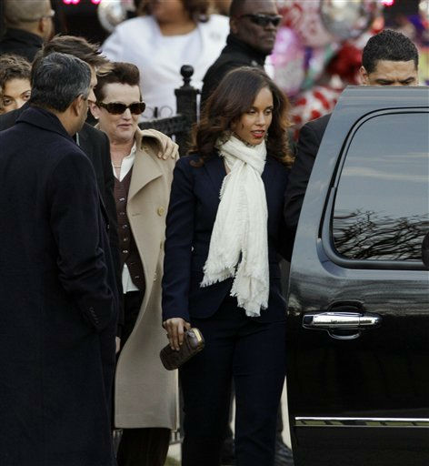 "<div class=""meta ""><span class=""caption-text "">Singer Alicia Keys, center, leaves after a funeral service for Whitney Houston at New Hope Baptist Church in Newark, N.J., Saturday, Feb. 18, 2012. Houston died last Saturday at the Beverly Hills Hilton in Beverly Hills, Calif., at the age 48. (AP Photo/Mel Evans) (AP Photo/ Mel Evans)</span></div>"