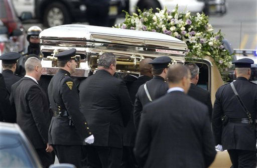 The coffin holding the remains of singer Whitney Houston is carried to a hearse after funeral services at the New Hope Baptist Church in Newark, N.J.,  Saturday, Feb. 18, 2012. Houston died last Saturday at the Beverly Hills Hilton in Beverly Hills, Calif., at the age 48. &#40;AP Photo&#47;Mel Evans&#41; <span class=meta>(AP Photo&#47; Mel Evans)</span>
