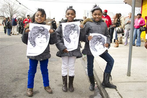 Fans holds up pictures of Whitney Houston near the funeral services for the singer at the New Hope Baptist Church in Newark, N.J., Saturday, Feb. 18, 2012. &#40;AP Photo&#47;Charles Sykes&#41; <span class=meta>(AP Photo&#47; Charles Sykes)</span>