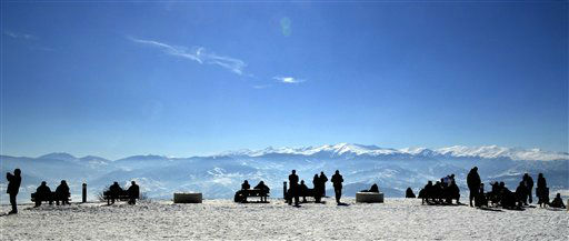 People enjoy the sun and the view at the top of Vodno Mountain above the town of Skopje, Macedonia, Sunday, Feb. 19, 2012. &#40;AP Photo&#47;Boris Grdanoski&#41; <span class=meta>(AP Photo&#47; BORIS GRDANOSKI)</span>