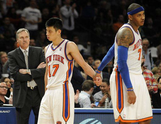 ADDS NAME OF COACH - New York Knicks&#39; Carmelo Anthony, right, holds Jeremy Lin&#39;s hand as he leaves the game after fouling out during the fourth quarter of an NBA basketball game against the New Jersey Nets, Monday, Feb. 20, 2012, at Madison Square Garden in New York. The Nets defeated the Knicks 100-92. Anthony shot 4 of 11 and scored 11 points. Lin finished with 21 points, nine assists and seven rebounds. At left is Knicks coach Mike D&#39;Antoni. &#40;AP Photo&#47;Bill Kostroun&#41; <span class=meta>(AP Photo&#47; Bill Kostroun)</span>