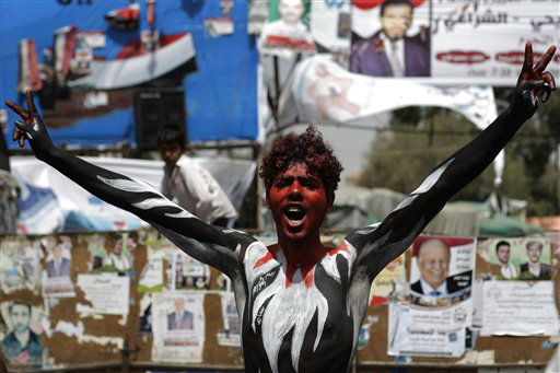 A protestor with Yemen&#39;s flag painted on his body shouts slogans during a rally demanding the prosecution of Yemen&#39;s President Ali Abdullah Saleh, in Sanaa, Yemen, Wednesday, Feb. 22, 2012. Sal eh has left power as part of a U. S.-backed deal that grants him immunity from prosecution. He is currently in the U. S. seeking treatment for burns sustained during a bomb blast in his palace mosque last June. &#40;AP Photo&#47;Hanoi Mohammed&#41; <span class=meta>(AP Photo&#47; Hani Mohammed)</span>