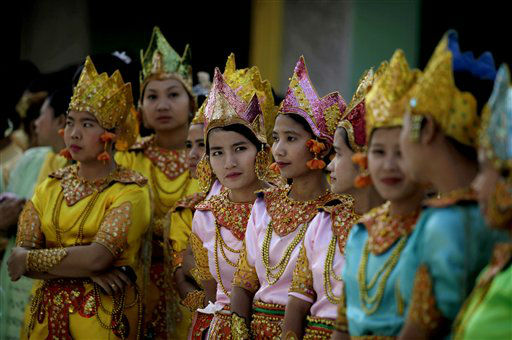 Myanmar girls in ceremonial dresses wait to take part in the 2600th anniversary celebrations of Shwedagon Pagoda in Yangon, Myanmar, Wednesday, Feb. 22, 2012. &#40;AP Photo&#47;Altaf Qadri&#41; <span class=meta>(AP Photo&#47; Altaf Qadri)</span>