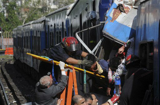 Firemen rescue wounded passengers from a commuter train after a collision in Buenos Aires, Argentina, Wednesday Feb. 22, 2012.  A packed train slammed into the end of the line in Buenos Aires&#39; busy Once station Wednesday, injuring over 300 morning commuters, Argentina&#39;s transportation secretary said. &#40;AP Photo&#47;Leonardo Zavattaro,Telam&#41; <span class=meta>(AP Photo&#47; Leonardo Zavattaro)</span>