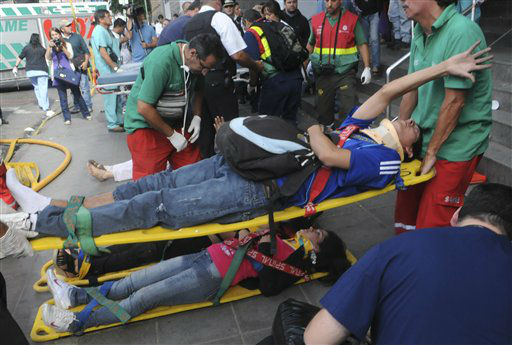 Paramedics carry away wounded passengers from a commuter train after a collision in Buenos Aires, Argentina, Wednesday Feb. 22, 2012.  A packed train slammed into the end of the line in Buenos Aires&#39; busy Once station Wednesday, injuring over 300 morning commuters, Argentina&#39;s transportation secretary said. &#40;AP Photo&#47;Leonardo Zavattaro,Telam&#41; <span class=meta>(AP Photo&#47; Leonardo Zavattaro)</span>